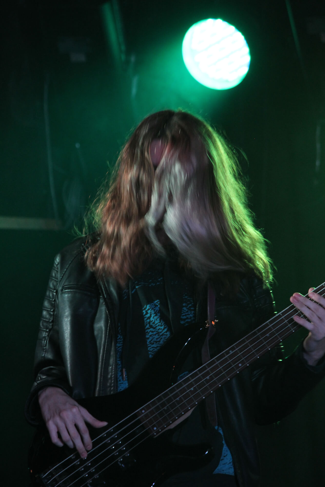 Playing bass for an adoring crowd.