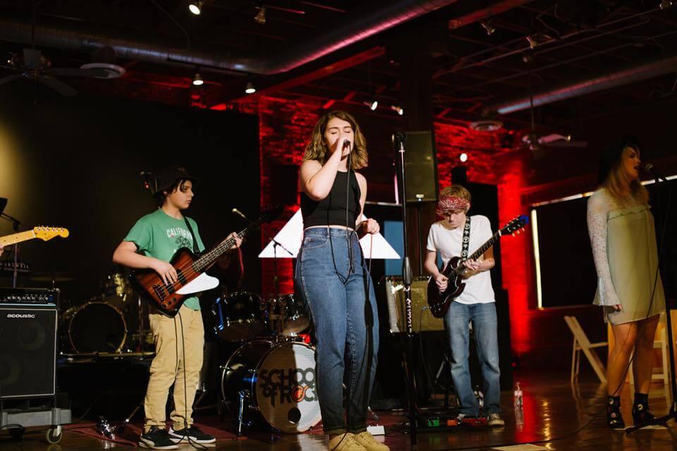 Our House Band performing at Llamapalooza.