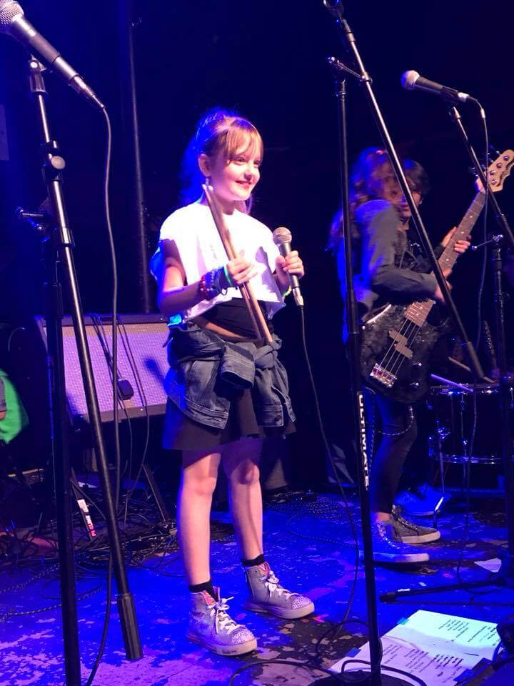 Drummer Aurora stepped up to the mic to sing during her last show.