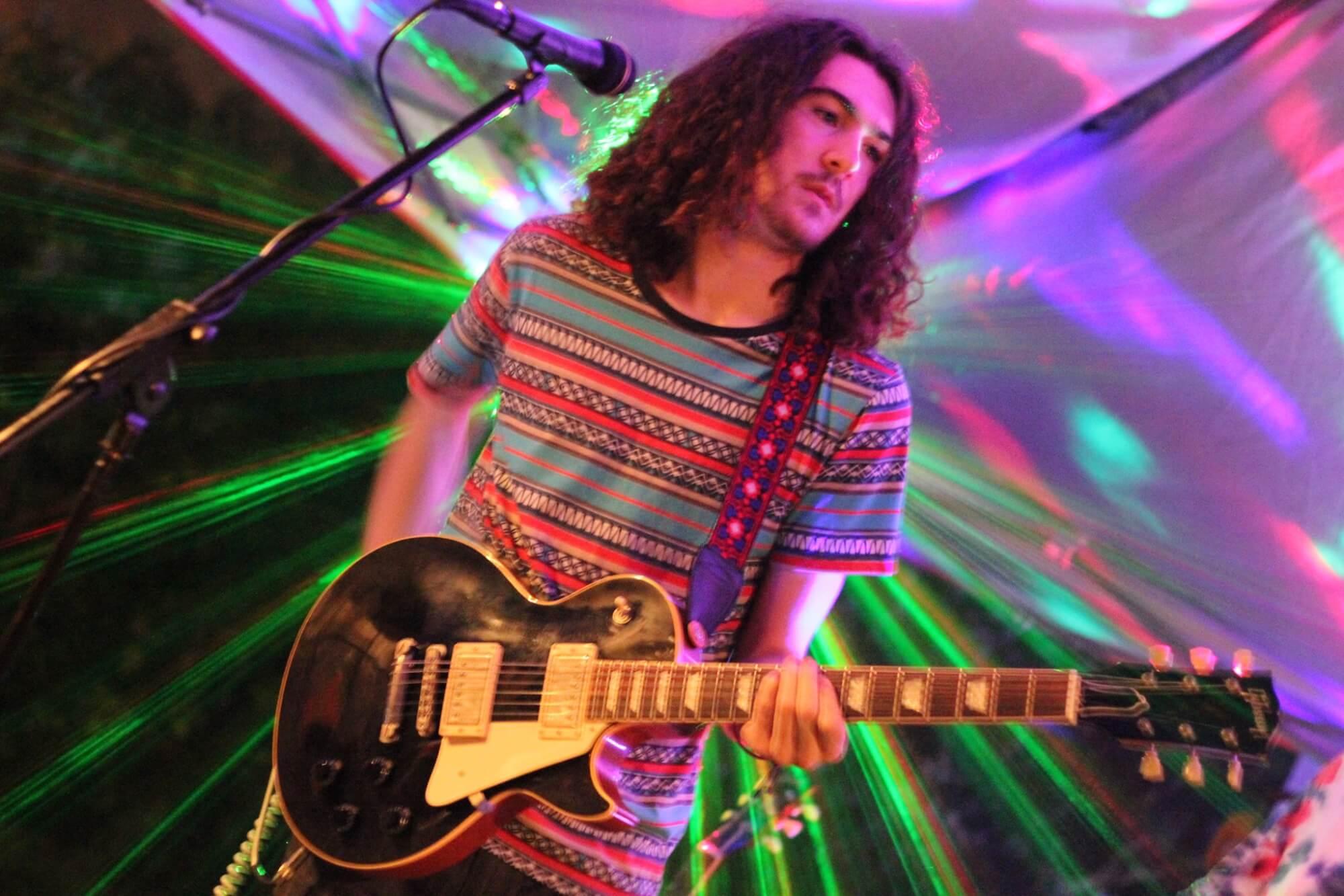 A recent School of Rock alumnus onstage.