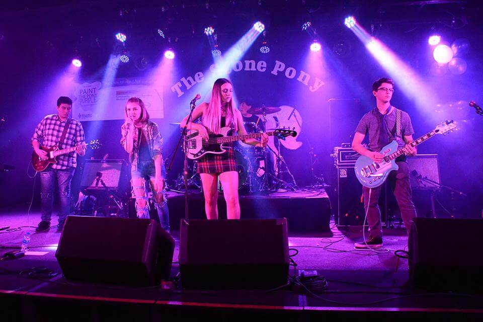Playing onstage at The Stone Pony.