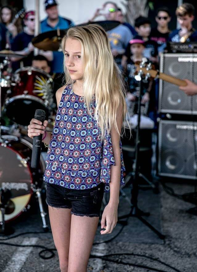 Taking her vocal lessons to the stage.