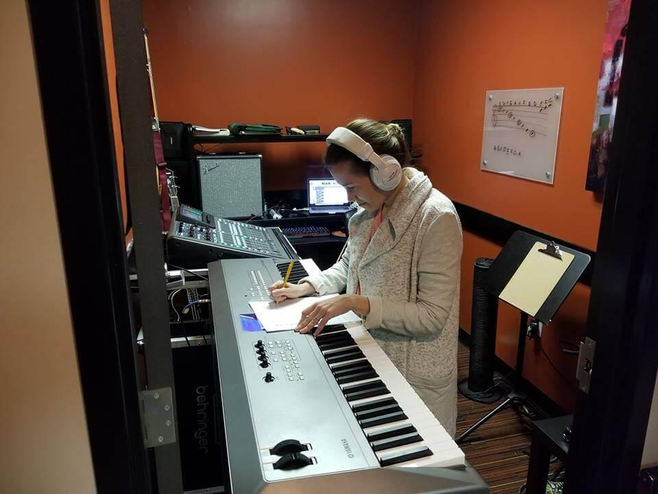 Ashley recording some keyboard tracks.
