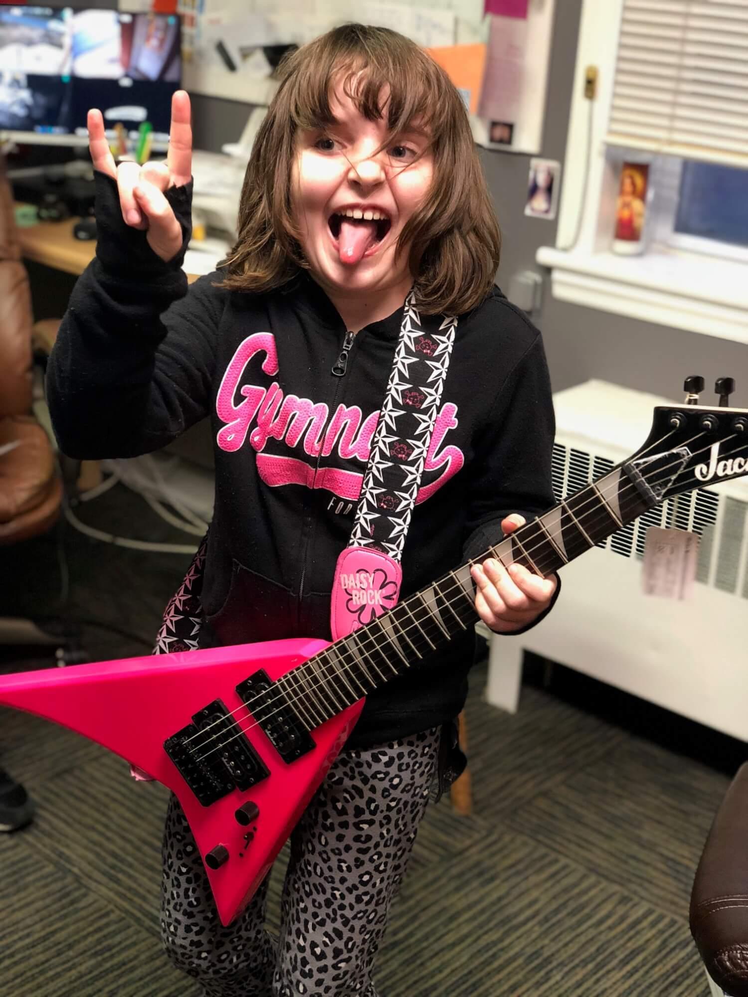 Juliana's first guitar.