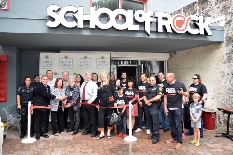 Owners and staff pose in front of the new North Miami location.