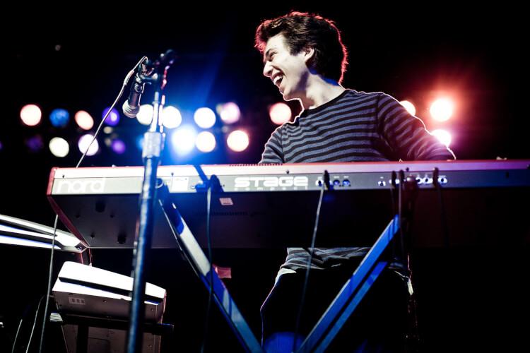 teenage boy playing the keyboard