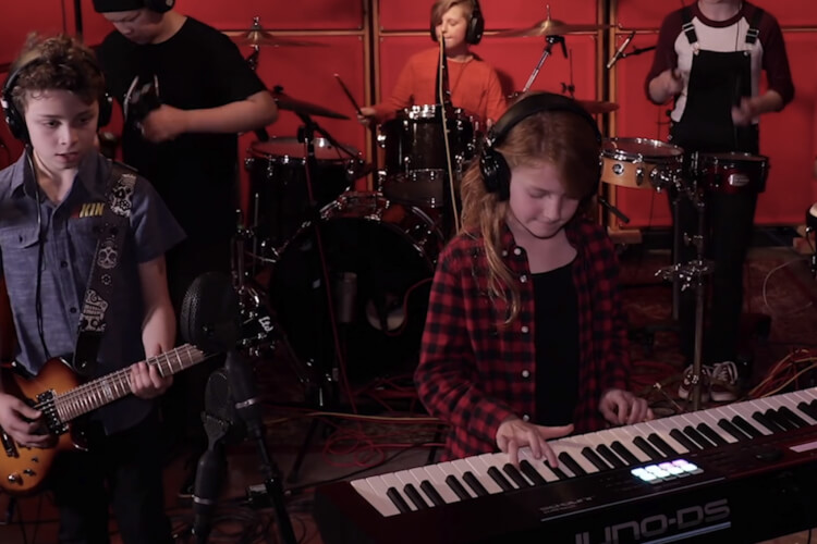 School of Rock students playing