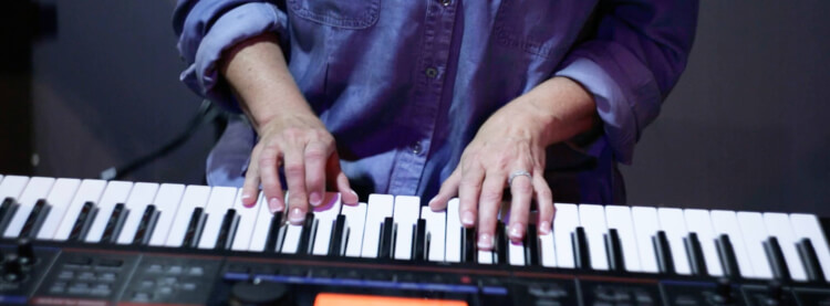 Student playing in adult music course