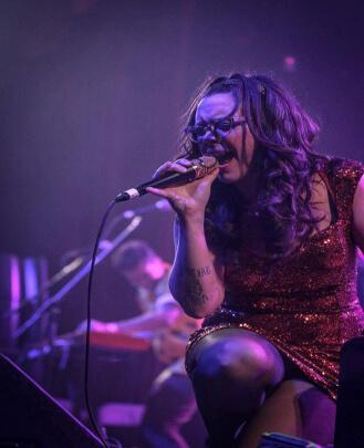 singing onstage, singing, school of rock, music teacher, music school