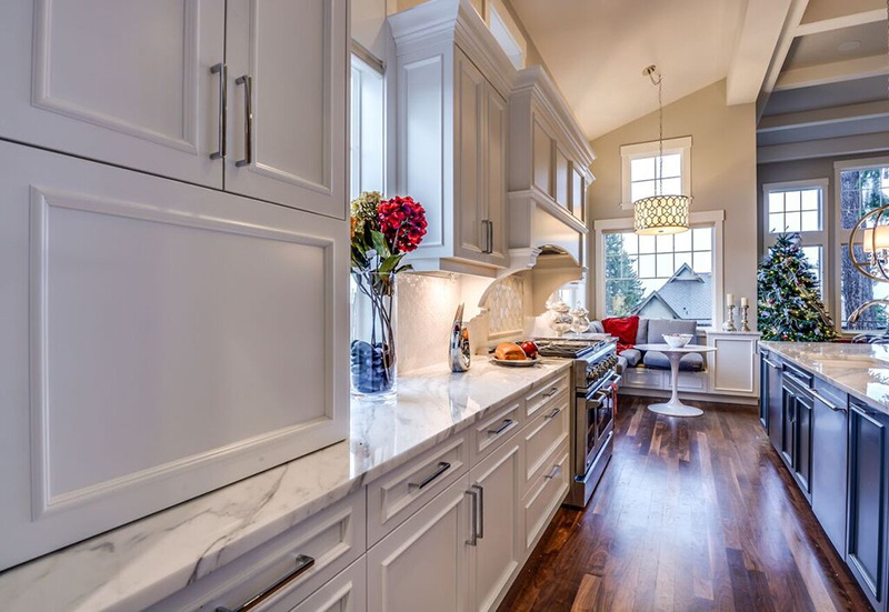 marble top kitchen with white kitchen cupboards