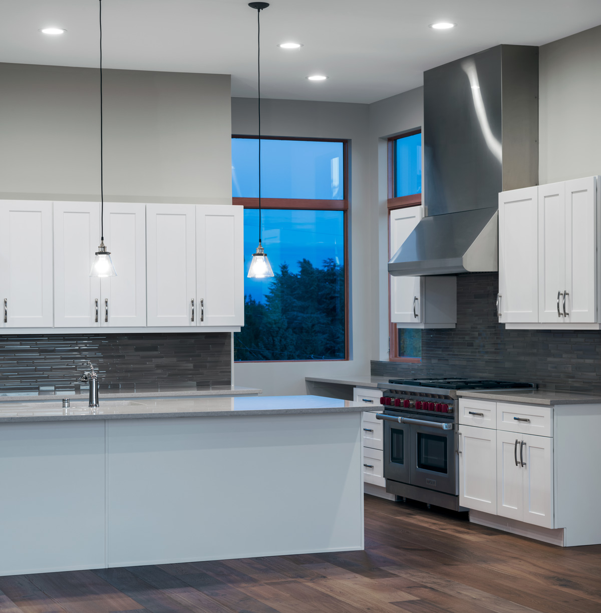 view of a kitchen var overlooking spacious living room