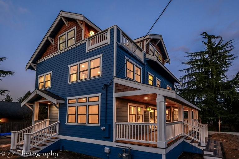 three story west seattle blue house with front porch