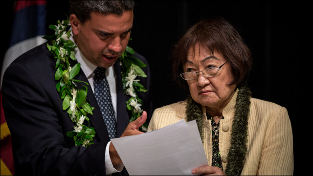 Honolulu City Council Vice-Chair Ikaika Anderson confers during break with fellow councilmember Ann Kobayashi at Memorial Auditorium at the Honolulu Mayor's Office of Culture and Arts on June 4, 2014.
