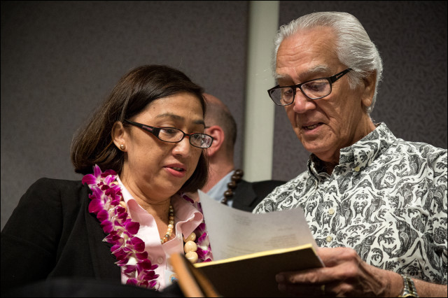 Assistant Director for Insular Affairs at the Department of Interior, Esther Kiaaina speaks with former Democratic Party Chairman Dante Carpenter after a public meeting on whether the United States should establish a government-to-government relationship with HawaiiÕs indigenous community held at the Hawaii State Capitol auditorium on June 23, 2014