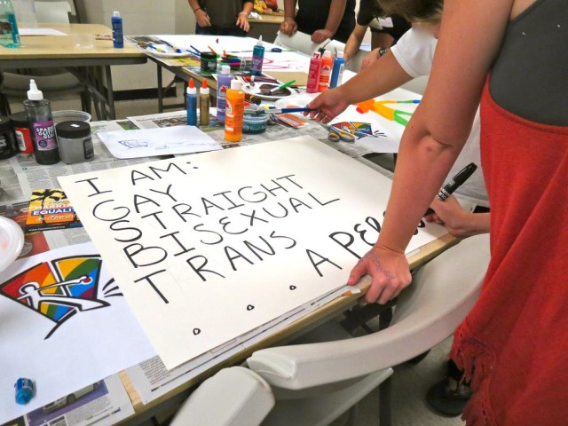Gay Straight Alliance student members paint banners