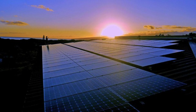 solar panels with sunset