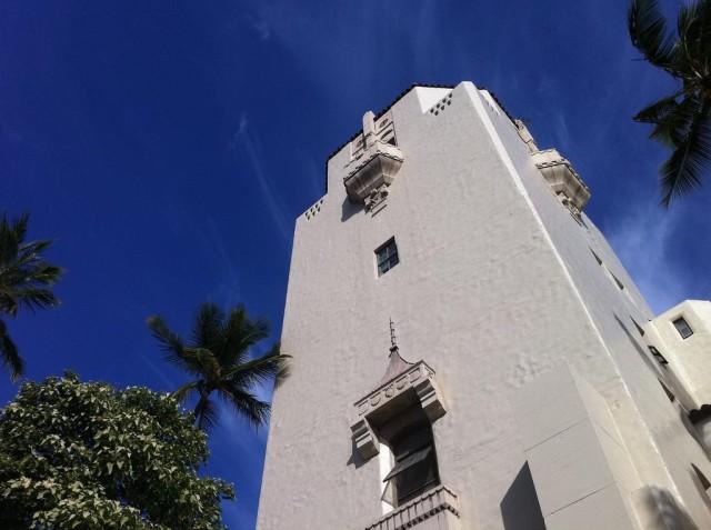 Honolulu Hale tower, blue sky, palms
