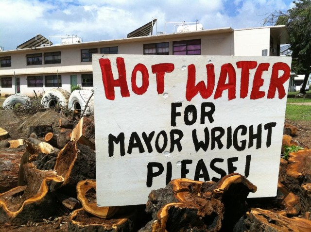 Residents protest lack of hot water at Mayor Wright in 2011. The planned redevelopment is intended to help the state afford necessary capital improvements.