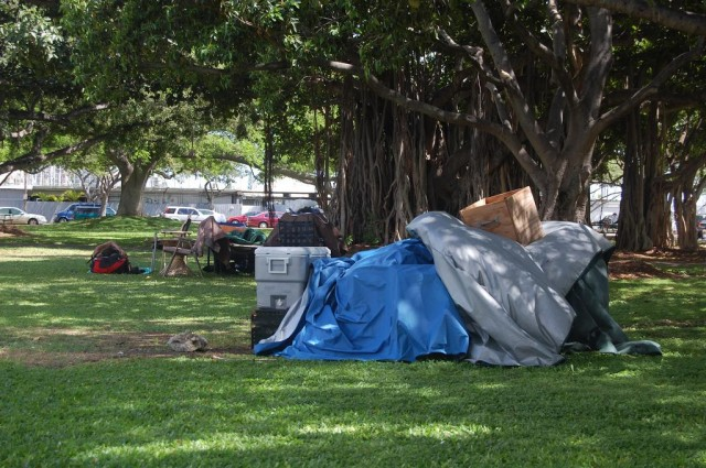 Signs of the homeless in Ala Moana Park.