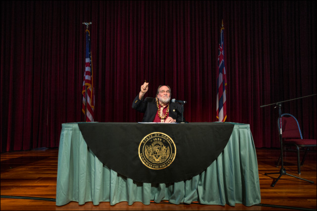 Hawaii Governor Neil Abercrombie holds up pen after signing into law the Same Sex Marriage Equality Act at the Hawaii Convention Center, Honolulu, Hawaii 11.13.13 ©PF Bentley/Civil Beat