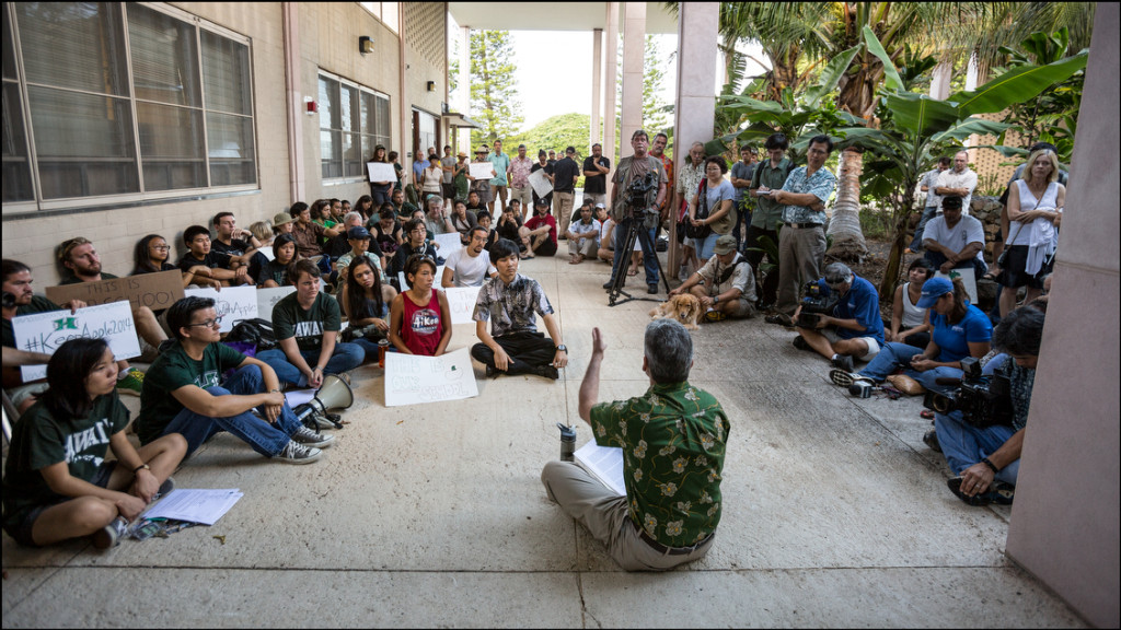 UH President David Lassner with back to camera outside Bachman Hall on the UH Manoa campus speaks to student and faculty about the termination of Manoa Chancellor Tom Apple on July 31, 2014