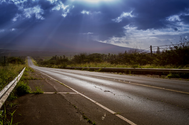 EMBARGOED FOR MOLOKAI 7.14.14 Rush hour on Maunaloa Highway on Molokai.