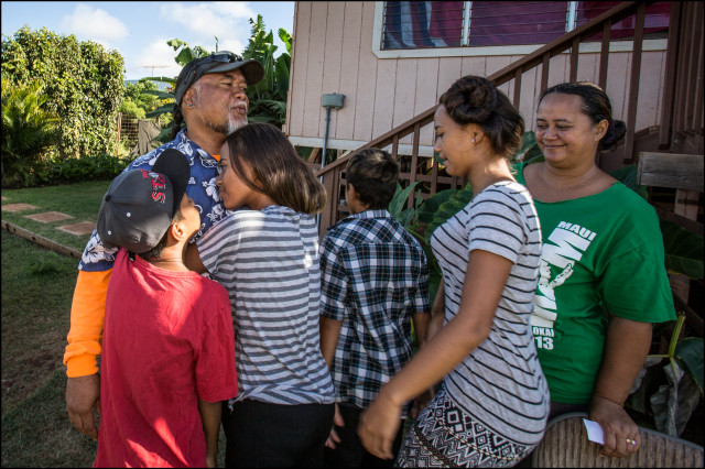 Mycogen's Samson Kaahanui gets goodbye hugs from his family before leaving for work. July 3, 2014