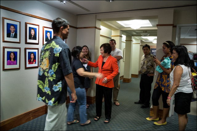 US Rep. Colleen Hanabusa greets staff in hallway after debating US Sen. Brian Schatz in the KITV studio on July 7, 2014.