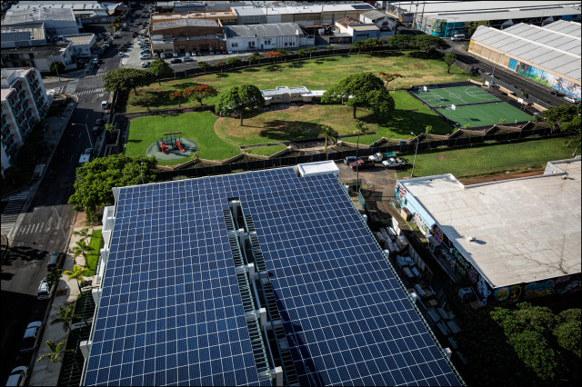 Solar panels on parking structure at 665 Halekauwila in Kakaako on July 21, 2014. Also shown is park which was refurbished by developer of building.