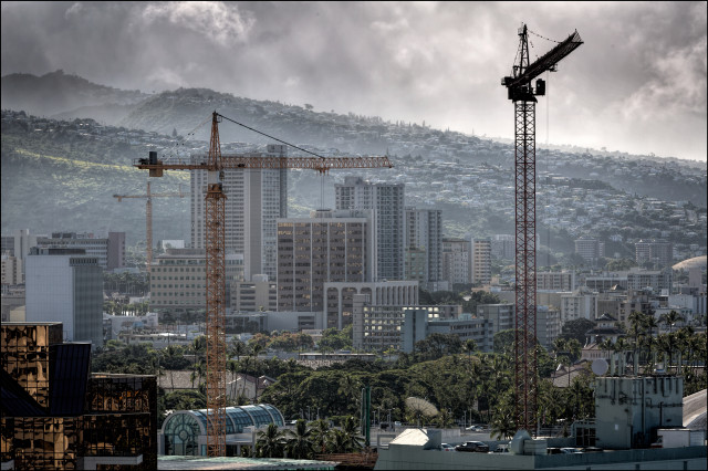 Building cranes on new construction in Kakaako area on July 21, 2014