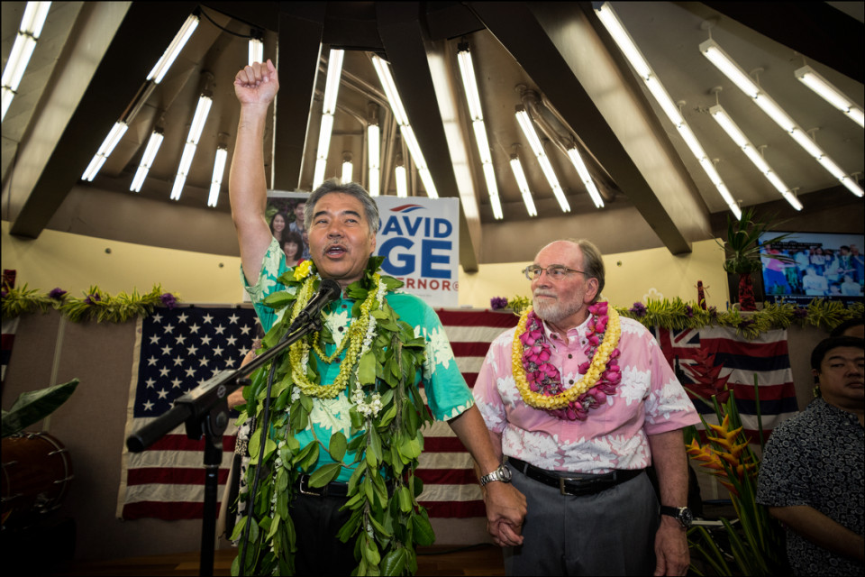 Gov. Neil Abercrombie looks on as a victorious Sen. David Ige speaks at his campaign headquarters after beating Gov. Abercrombie in the state Primary on August 9, 2014.