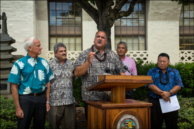 Honolulu Mayor Kirk Caldwell, Kauai Council member Mel Rapozo, Kauai Mayor Barnard Carvalho, Hawaii County Mayor Billy Kenoi and Maui Mayor Alan Arakawa hold news conference in front of Honolulu Hale to give their reaction to a federal court decision that struck down a Kauai County ordinance that requires biotechnology companies to disclose their cultivation of genetically modified crops and use of restricted pesticides. August 25, 2014