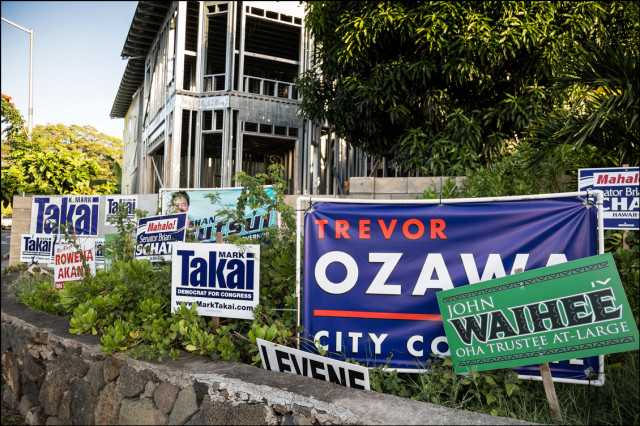 Campaign signs along on one corner of Kalanianaole Highway in Aina Haina on August 27, 2014