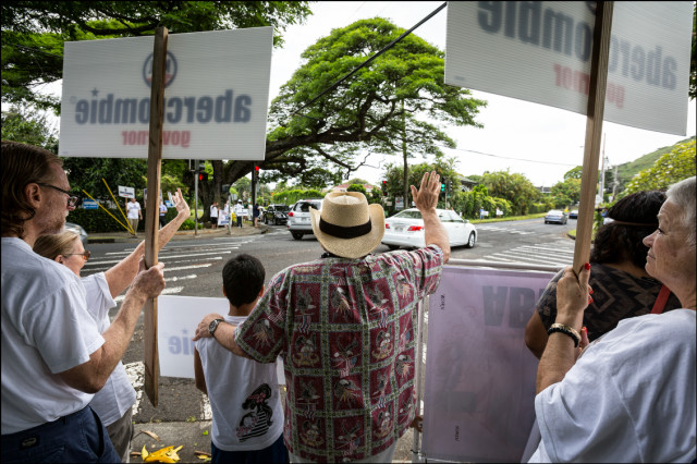 Gov. Neil Abercrombie does some last minute sign waving in Manoa on Primary Day on August 9, 2014