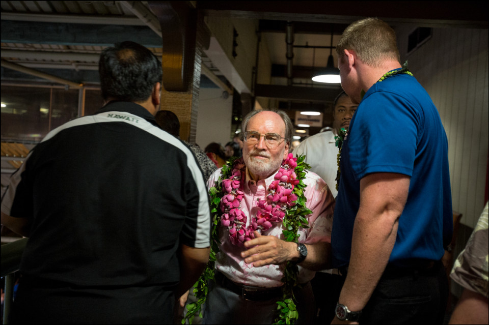 Gov. Neil Abercrombie walks down the second floor hall from his campaign headquarters to speak to the crowd and media assembled in the stage area below on Primary Night 8.9.14