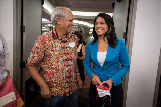 State Sen. Mike Gabbard and his daughter US Rep. Tulsi Gabbard enter the Democratic Party Unity Breakfast on August 10, 2014