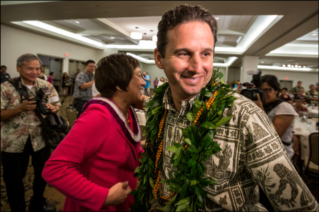 Colleen Hanabusa and Brian Schatz hug at the Democratic Party Unity Breakfast on the morning after the primary, August 14, 2014.  At this time it is still uncertain which candidate on the Senate race had won.