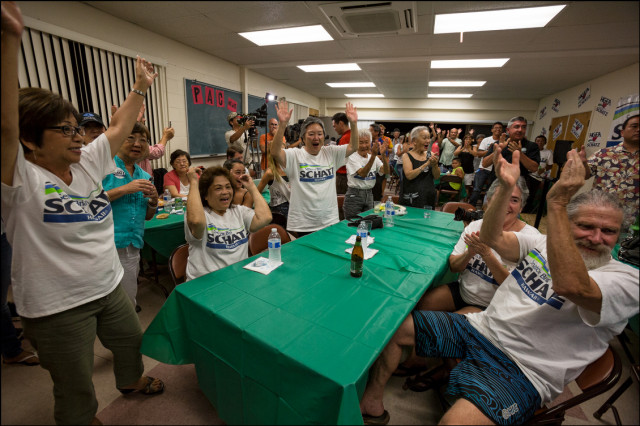 Sen. Brian Schatz supporters at the Hawaii Government Employees Association building in Hilo break out in celebration after they hear results of a special election in which Schatz won over Rep. Colleen Hanabusa on August 15, 2014