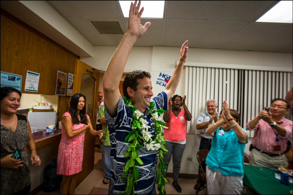 Sen. Brian Schatz raises his arms in victory as he walks into the Hawaii Government Employees Association building in Hilo after he heard the results of a special election in which Schatz won over Rep. Colleen Hanbusa on August 15, 2014