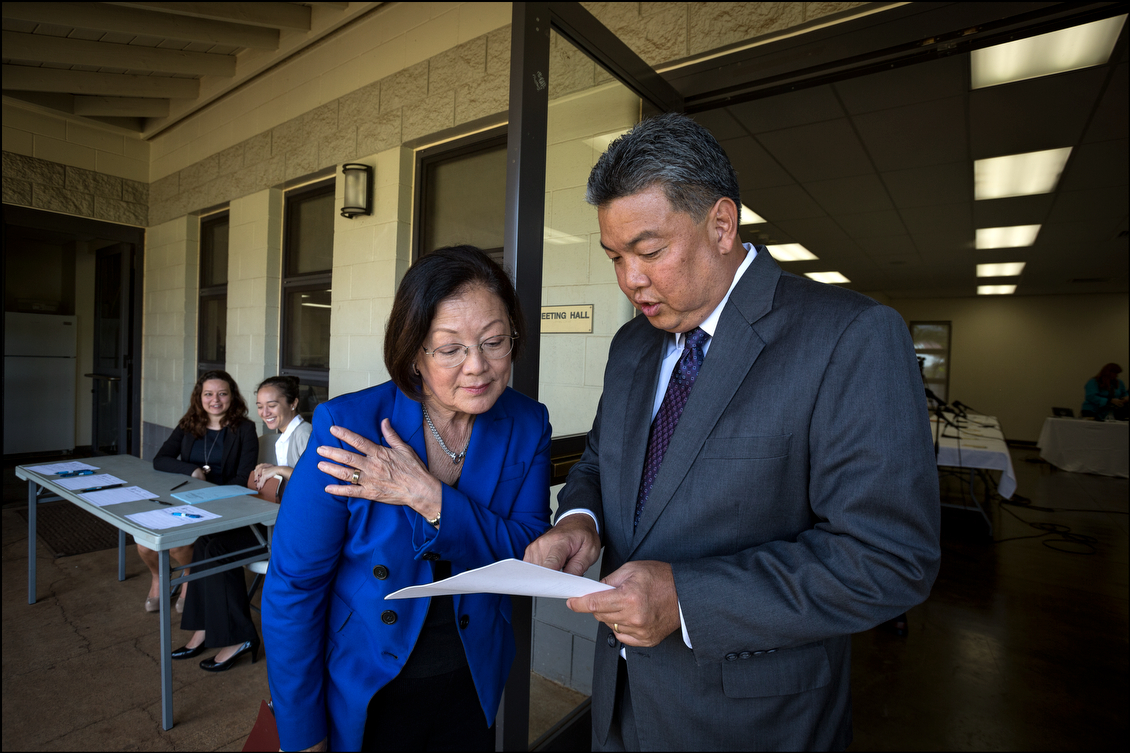 U.S. Sen. Mazie Hirono and state Rep. Mark Takai, the Democratic nominee for the 1st Congressional District, go over the schedule before the start of a Senate Veteran's Affairs Committee Field Hearing on Aug. 19. The hearing was held to find out what the VA is doing to improve conditions for vets.