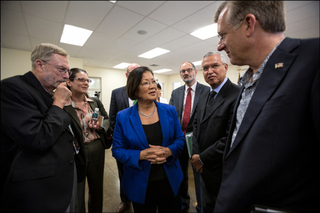 Sen. Mazie Hirono talks to group of VA staff after the end of a Senate Veteran's Affairs Committee Field Hearing at the Oahu Veterans Center on August 19, 2014.