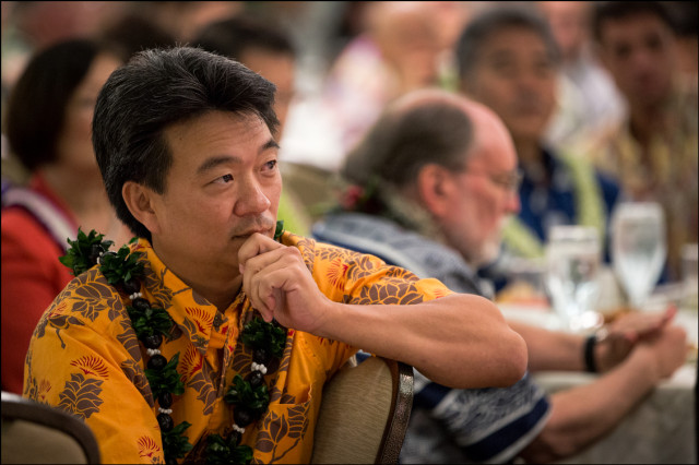 Lt. Gov. Shan Tsutsui listens to speakers with Gov. Neil Abercrombie and Sen. David Ige in the background at the Democratic Party Unity Breakfast on August 10, 2014