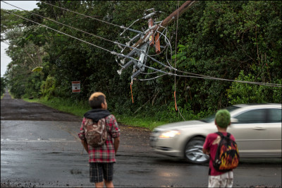 WAITING FOR THEIR RIDE Children wait for school bus facing downed power lines tin the Paradise Park section of Puna on August 12, 2014.