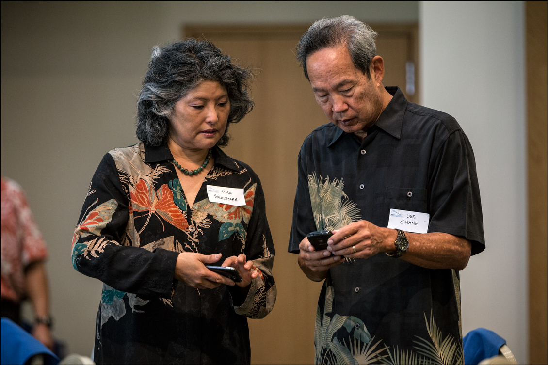 Hannemann's wife Gail and the Independent Party candidate for lieutenant governor, Les Chang, check their smart phones before the start of the forum. Mufi Hannemann said he wants to transfer zoning power of the Hawaii Community Development Authority to the city so that it can facilitate the creation of more affordable housing.