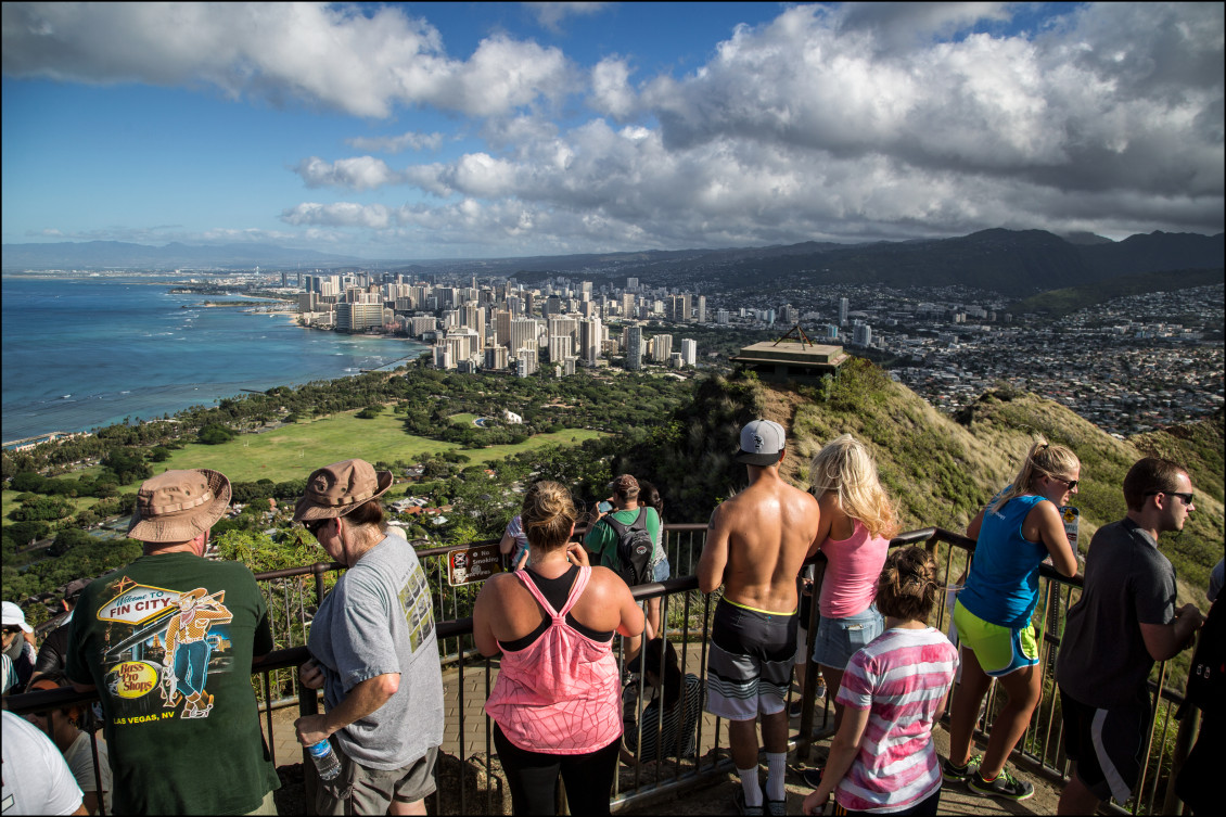 """Hikers at the top enjoy one of the best views of the city. Native Hawaiians built heiaus, monuments to the gods, on the crater's slopes. British sailors are believed to have dubbed it """"Diamond Head"""" because they thought crystals glittering in the cone's ashy soil looked like diamonds."""