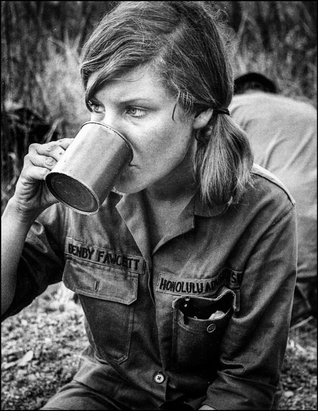 Reporter Denby Fawcett drinks at the Rockpile in Vietnam during war in Honolulu shirt