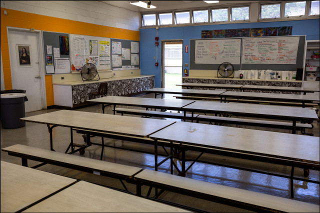 Empty hot classroom with fans Ilima Intermediate School in Ewa Beach. The temperature was measured at 94.1F with fans going and no student inside on September 12, 2014