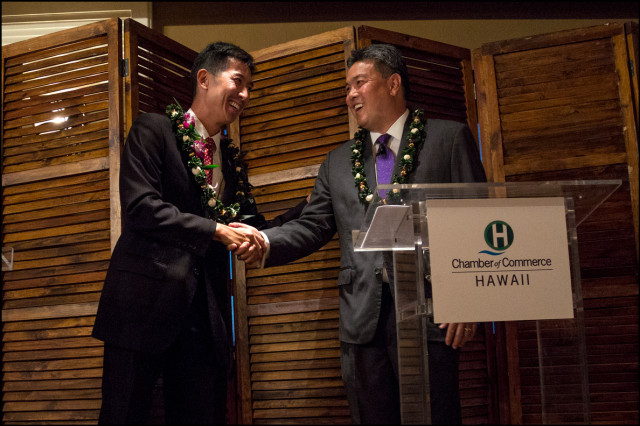 Djou and Takai shake hands at end of Chamber of Commerce debate on September 23, 2014