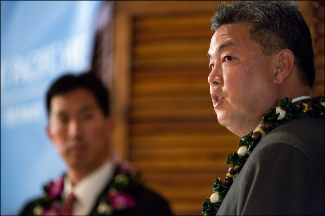 Mark Takai speaks as challenger Charles Djou looks on in background during congressional debate at the Plaza Club in Honolulu on September 23, 2014