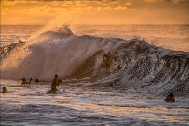 SUNRISE DROP A bodyboarder makes the drop at sunrise at Sandy Beach on September 16, 2014